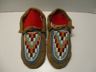 native american moccasins in excellent condition with smoked elk or moose hide .