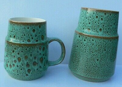 Two items of vintage Poole Pottery - a vase and mug in turquoise green