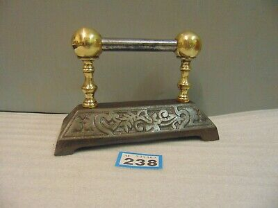 Antique Cast Iron And Brass  Poker Rest / Door Stop 238
