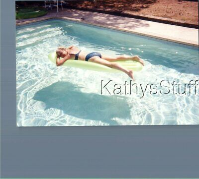 Found Color Photo C_8841 Pretty Woman In Bikini Laying In Pool