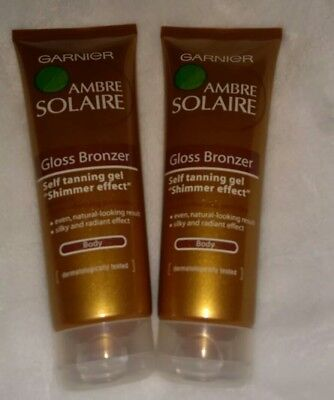 2 X Garnie  Ambre Solaire  Gloss Bronzer Self Tanning Gel Shimmer  Effect  Body