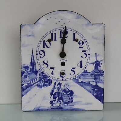 Antique enamel blue and white wall clock.