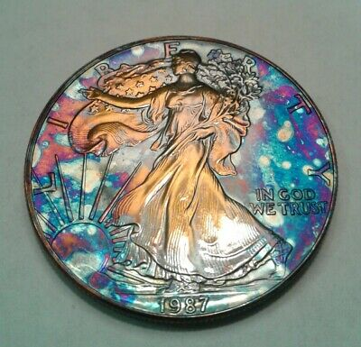 1987 - american silver  eagle dollar with beautiful toning, * TONED $.