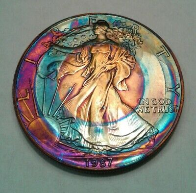 1987 american silver  eagle dollar with beautiful toning TONED . $