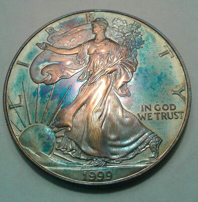 1999  1oz silver american eagle dollar with beautiful toning, * TONED $