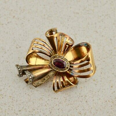 Antique French 18k gold sapphire/amethyst diamond bow brooch owned by Mirka Mora