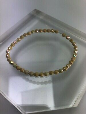 """Vintage Bracelet 7"""" Elastic Small Faceted Creme Iridescent Bead Strand"""