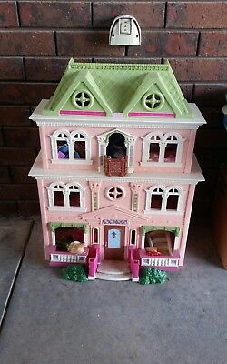 Dolls house girls toy with furniture and some dolls