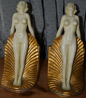 Pair of Art Deco Bookends Of Nude Ladies Standing On Gilt Sea Shell Bases