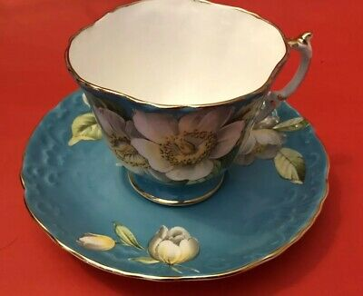 Vintage Aynsley Turquoise Blue tea cup and saucer white Anemone floral England