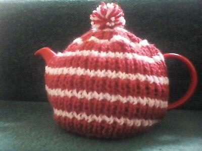 Hand knitted tea cosy (small, fits two cup teapot) terracotta/peach