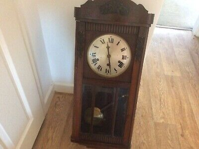 vintage oak wall clock with pendulum and original key.