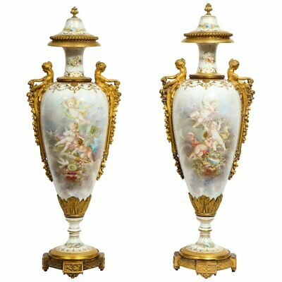 Monumental Pair of French Ormolu-Mounted White Sevres Porcelain Vases and Covers