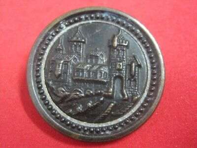 19th century button in metal with a monument