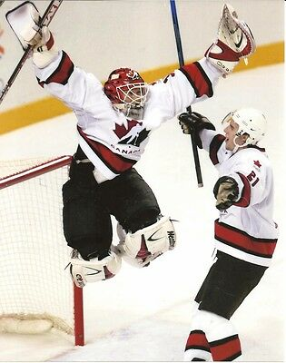 TEAM CANADA 8x10 ACTION PHOTO Olympic Hockey Champs MARTIN BRODEUR & SIMON GAGNE