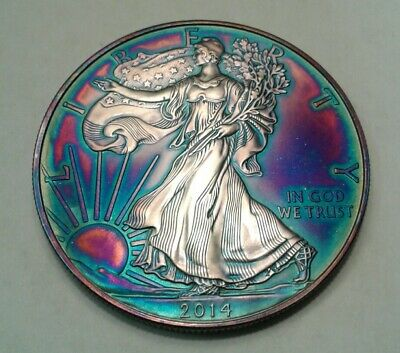 2014 1oz. silver american eagle dollar with beautiful toning, TONED.,