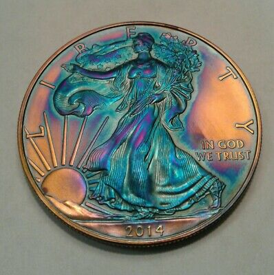 2014 1oz. silver  american eagle dollar with beautiful toning,  * TONED $