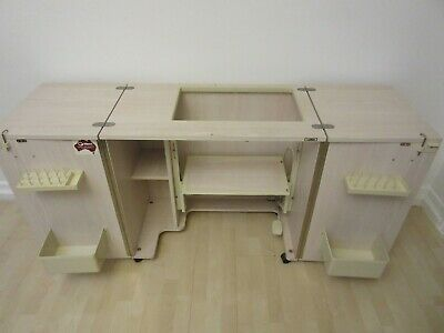 Sewing machine cabinet Horn w lift extendable table storage shelves baskets