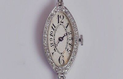 Oval Lady's Art Deco solid Platinum Exaggerated Dial  Wristwatch by R.W. Geneve