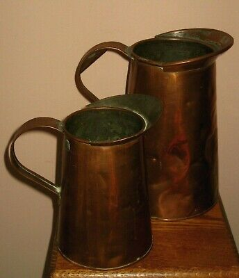 Vintage Pair of Hand Hammered Copper Tin Lined Primitive Pitcher's