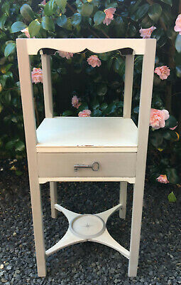 Really pretty vintage table with drawer, silver star motif, key handle