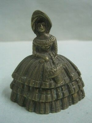 Antique small Bronze Bell a woman  with a basket in the arm
