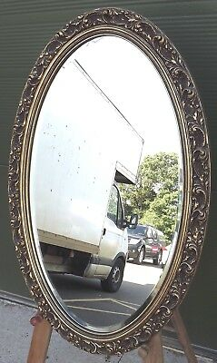 Decorative Gil-Framed Oval Bevel-Edged Wall Mirror in the Antique Style