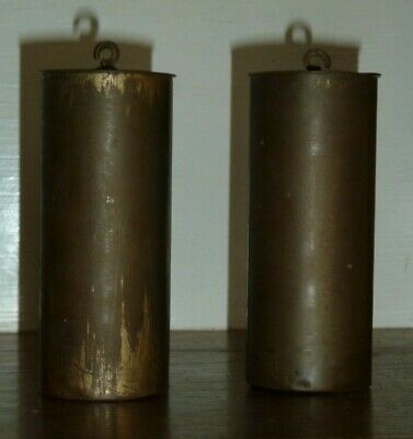 Pair of antique brass cased wall clock weights approx 1400g each