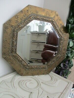 beautiful antique arts and crafts mirror with beveled glass.