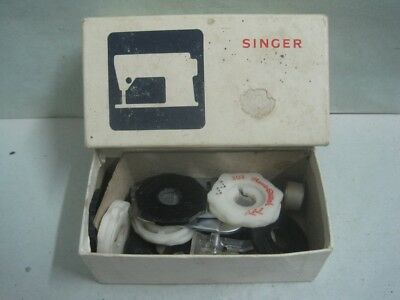 Antique box Singer with accessories for sewing machine
