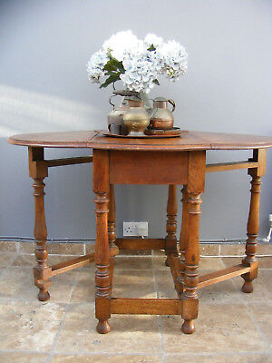 Antique solid oak drop leaf centre table / kitchen table / dining table