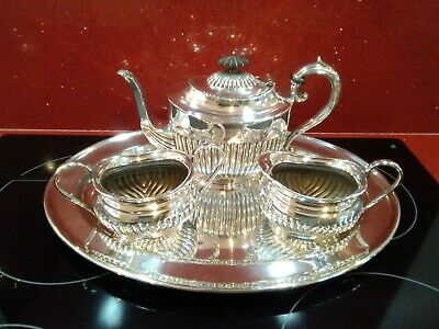 Antique silver plated 4 piece tea set tea pot cream sugar & tray