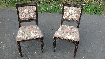 A pair of victorian dining chairs for restoration.
