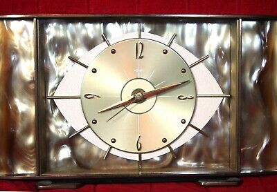 Vintage 50s? Metamec Groovy Mantel clock in brass? early pearl plastic EYE face