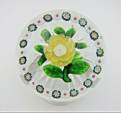 Antique Baccarat Buttercup Paperweight with Millefiori Garland and Star Cut Base