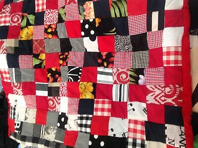 Patchwork quilt in red and White and black