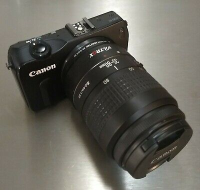 Canon EOS M with EF Lens adapter and lens.