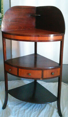 Georgian mahogany corner wash stand with inlays in ebony and lighter wood.