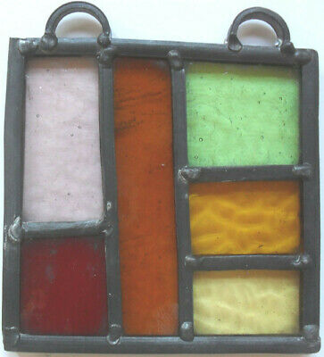 stained glass panel , with differing types of Glass .