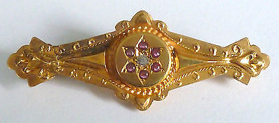 A Victorian 9Ct Gold Brooch Set With Rubies & A Central Diamond