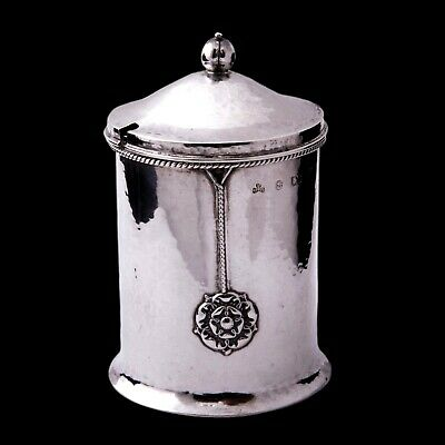 An A E Jones silver arts and crafts condiment jar, Cymric style