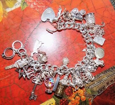 Vintage sterling silver heavy bracelet 1978, 29 charms, beautiful quality 120g