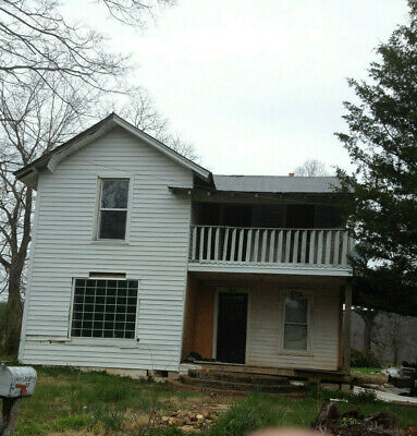TWO STORIE 1930's HOUSE W/ LOW BACK TAXES UP FOR BIDS