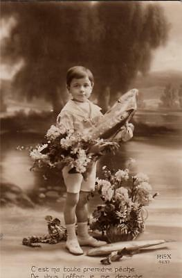 T11.Vintage French Greetings Postcard.April 1st.Boy with bouquet of fish/flowers