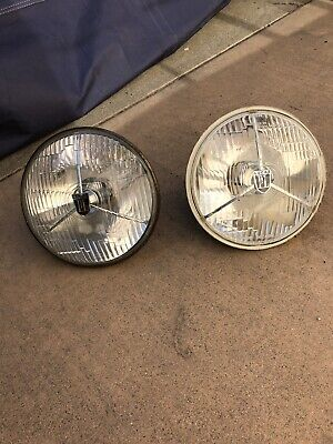 """Pair of Lucas Tripod Style PL700 7"""" Round Headlamps with Bulbs."""