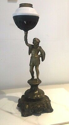 spelter brass figural oil lamp with small white pottery fount