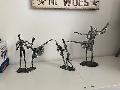 Very heavy silver/bronze dancing statues. Dancers. Viewing Welcome!