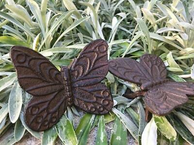 A Pair of Cast Iron Butterfly Garden Ornaments Rustic Brown
