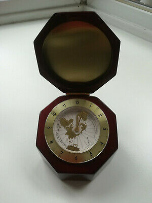 World clock in octagonal heavy lacquered wood case