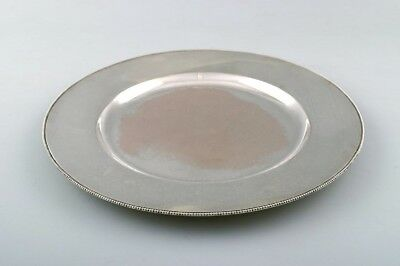 Evald Nielsen coverplate of hammered sterling silver with beaded border. 1930s